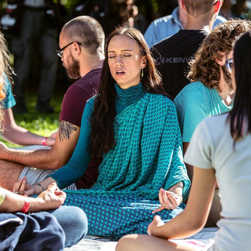 Group of people practicing OM Chanting